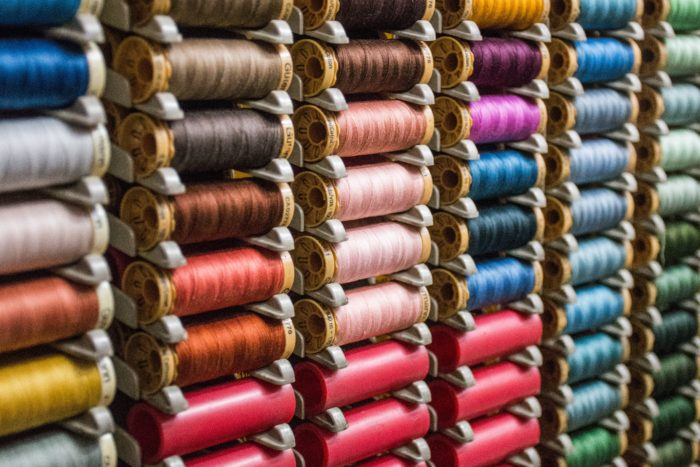 rack of multicolored embroidery threads