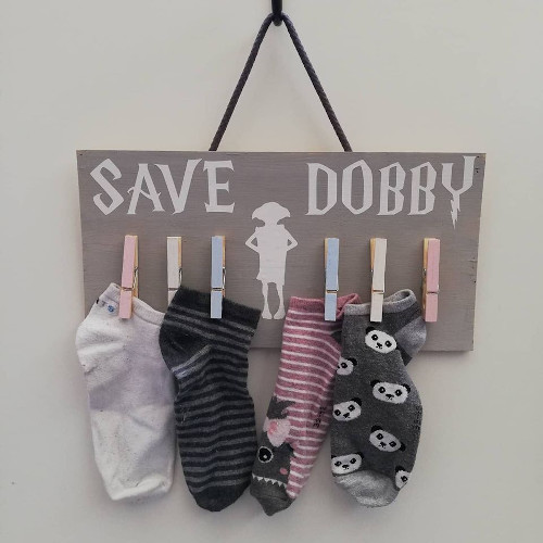 cardboard sock hanger with dobby quote