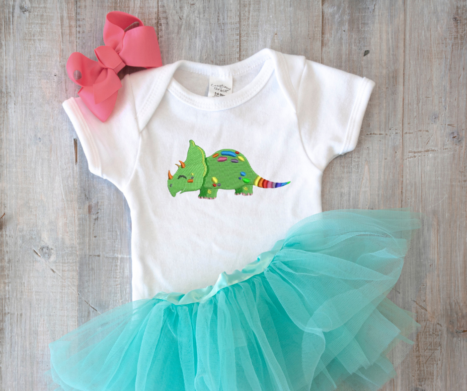 Get this design here: Rainbow colored dinosaur.