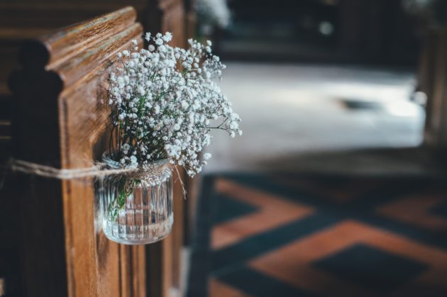 This glass is attached to the bench. This way, you can add water for the flowers.