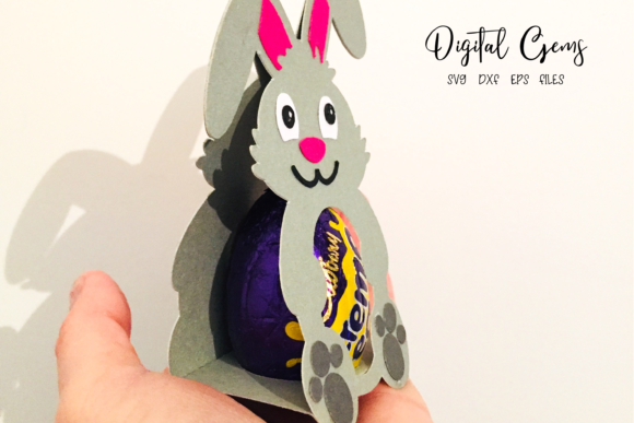 Download Free Rabbit Easter Egg Holder Design Graphic By Digital Gems for Cricut Explore, Silhouette and other cutting machines.