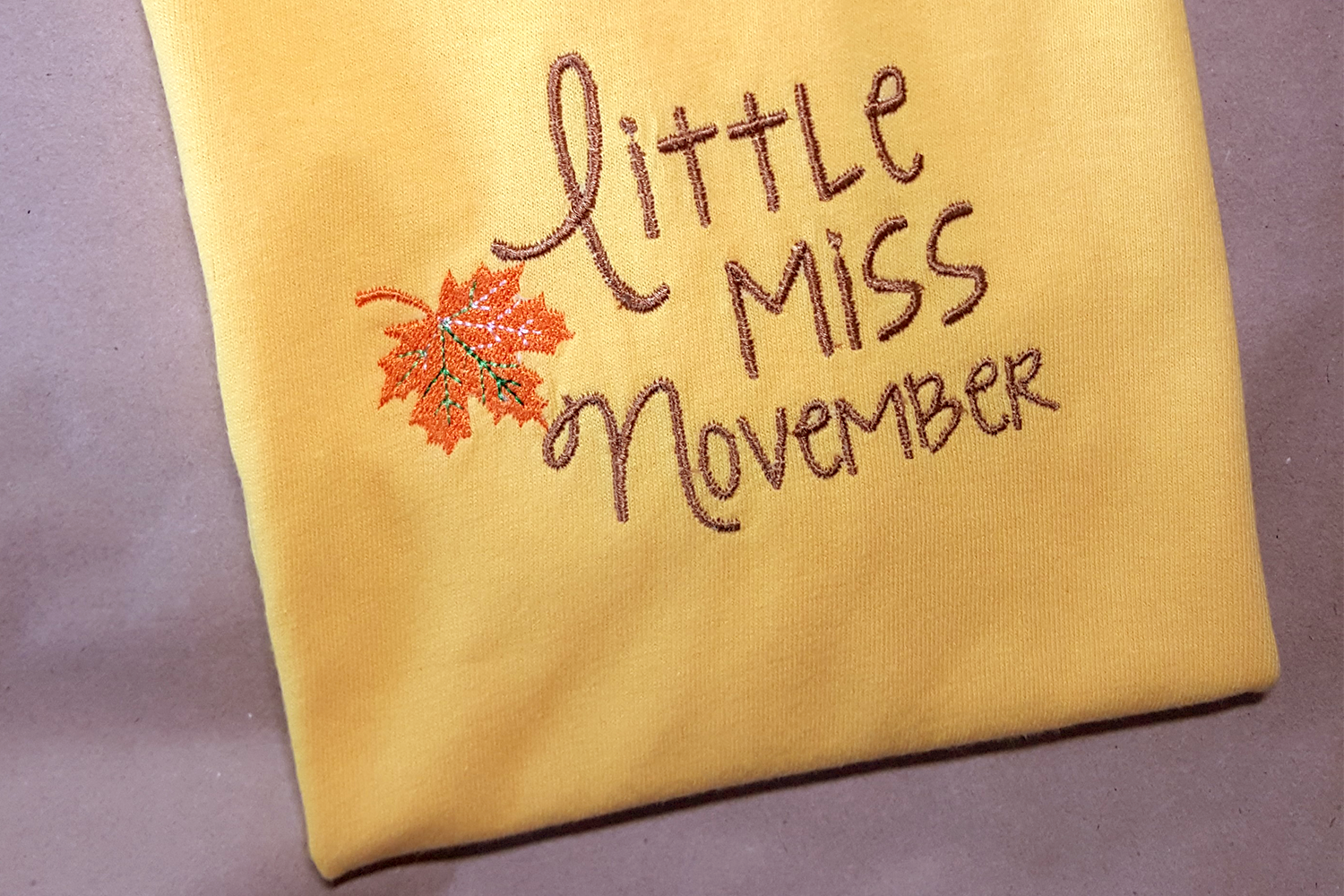 Download Free Little Miss November Fall Leaf Applique Creative Fabrica for Cricut Explore, Silhouette and other cutting machines.