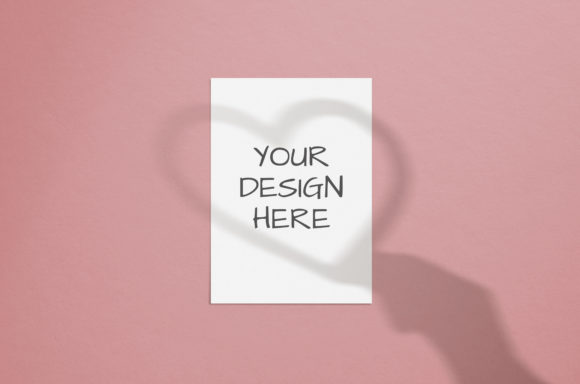 Print on Demand: Card Mockup with Shadows Heart in Hand Graphic Product Mockups By Natalia Arkusha