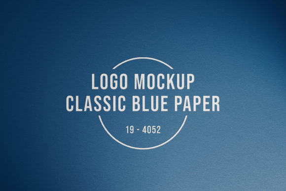 Logo on Classic Blue Paper Mockup Graphic Product Mockups By suedanstock