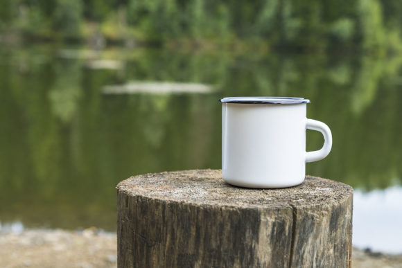Download Free White Enamel Mug Mockup With Tree Stump Graphic By Tasipas for Cricut Explore, Silhouette and other cutting machines.