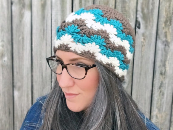 Download Free Falling Snowflakes Beanie Pattern Graphic By Knit And Crochet for Cricut Explore, Silhouette and other cutting machines.