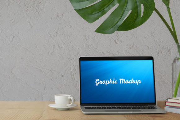 Notebook Mockup with Plant and White Cup Graphic Graphic Templates By knou