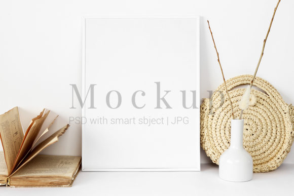 Print on Demand: Photo Frame Mockup with Straw Bag Grafik Produktmodelle von PawMockup