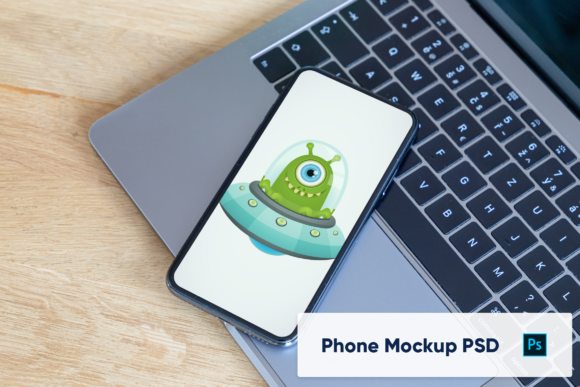 Download Free Iphone On Macbook Keyboard Mockup Graphic By Marian Kadlec for Cricut Explore, Silhouette and other cutting machines.
