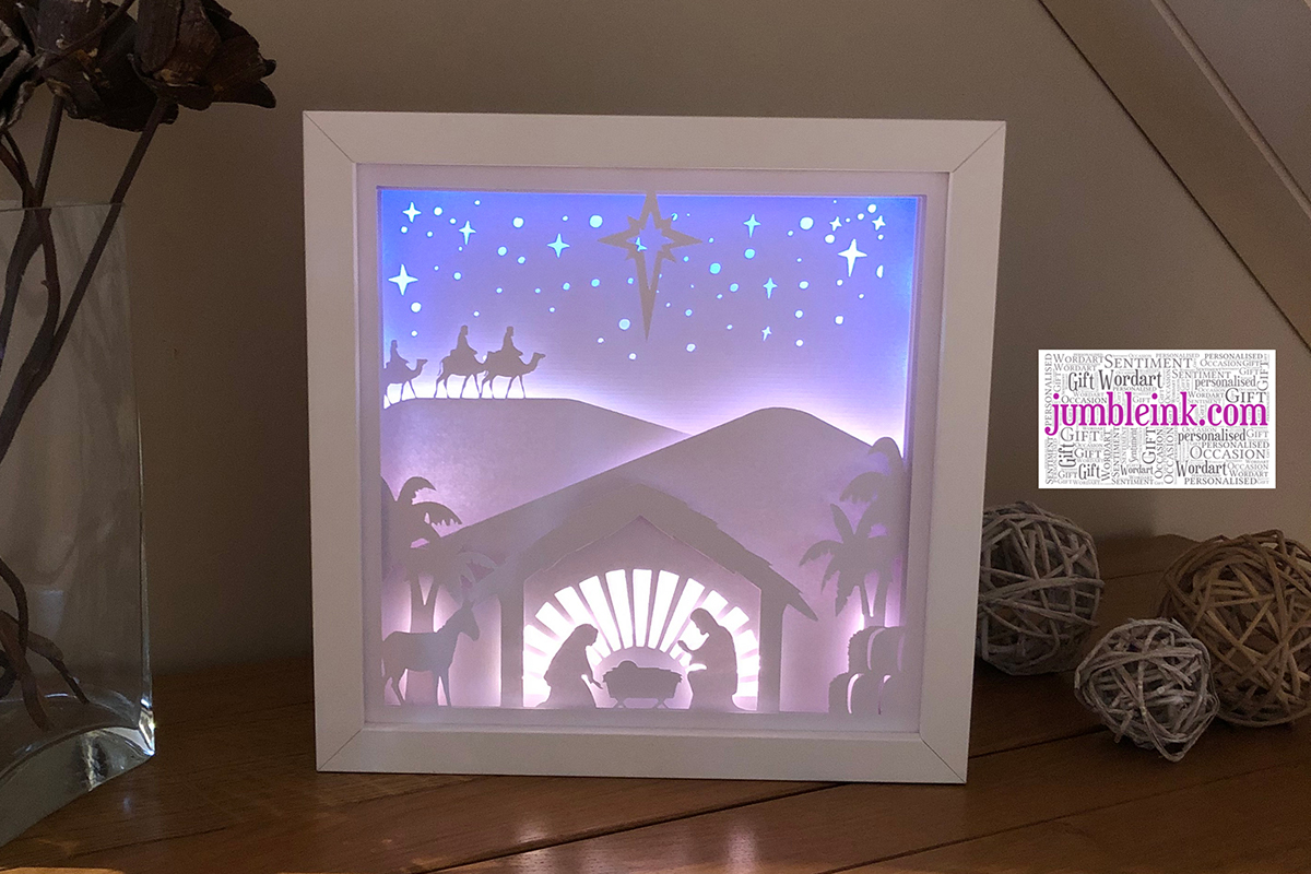 Download Free Nativity 3d Paper Cut Light Box Graphic By Jumbleink Digital for Cricut Explore, Silhouette and other cutting machines.