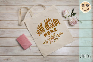 Print on Demand: Tote Bag Mockup with Roses and Notepad. Graphic Product Mockups By TasiPas