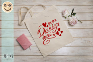 Print on Demand: Tote Bag Mockup with Roses and Notepad. Graphic Product Mockups By TasiPas 3