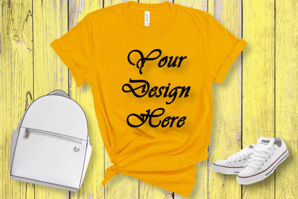 Download Free Mockup Bella Canvas 3001 Yellow T Shirt Graphic By Mockupsbygaby for Cricut Explore, Silhouette and other cutting machines.