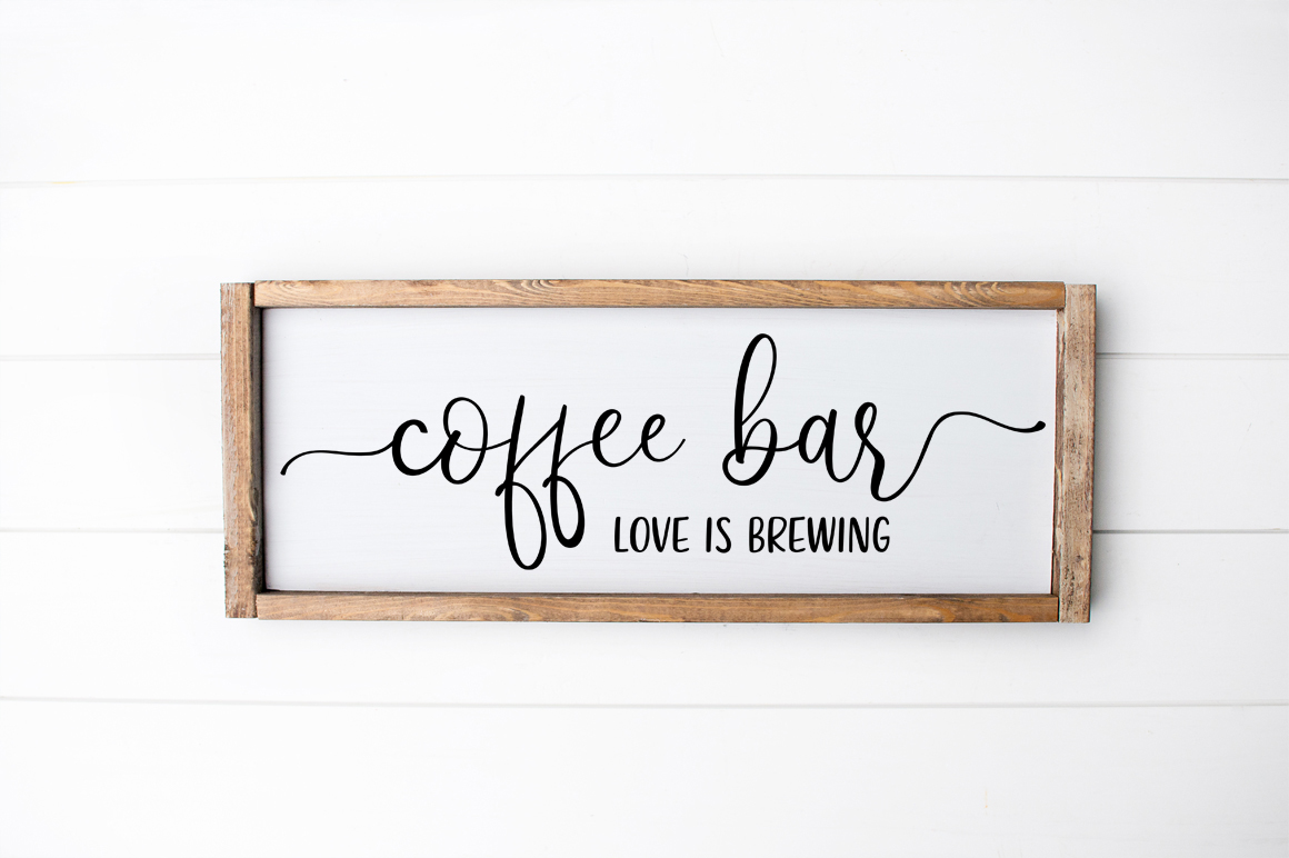 Download Free Coffee Bar Love Brews Here Kitchen Sign Graphic By Simply Cut Co for Cricut Explore, Silhouette and other cutting machines.