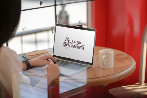 Young Girl Typing on Mock Up Laptop Graphic Product Mockups By bongkarngraphic
