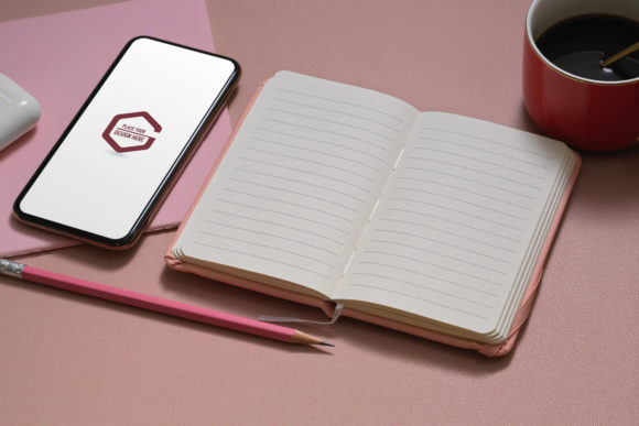 Mock-up Smartphone and Open Notebook Graphic Product Mockups By bongkarngraphic