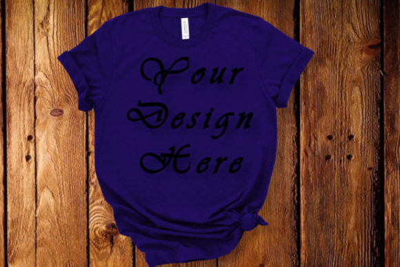 Mockups Blue T-shirt, Wooden Backgrond Graphic Product Mockups By MockupsByGaby
