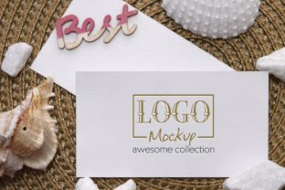 Print on Demand: Logo Mockup with White Stones, Seashels Graphic Product Mockups By bywahtung
