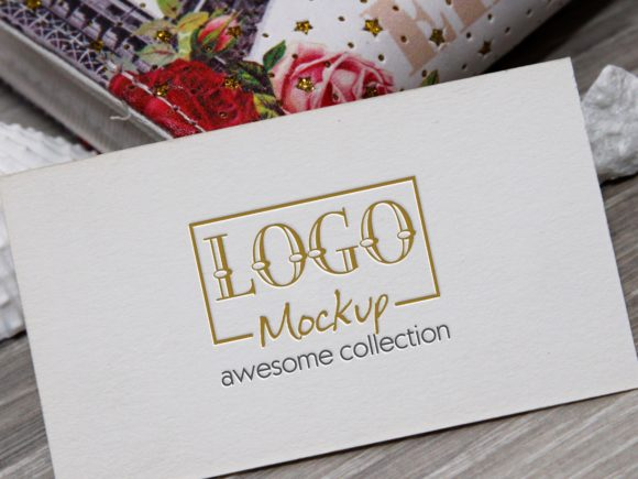 Print on Demand: Logo Mockup with White Stones Seashels Graphic Product Mockups By bywahtung
