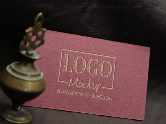 Print on Demand: Logo Mockup with Vintage Miniature Lamp Graphic Product Mockups By bywahtung