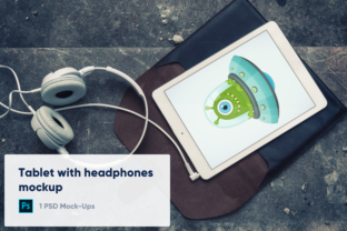 Print on Demand: Old IPad Air with Headphones Mockup Graphic Product Mockups By marian.kadlec