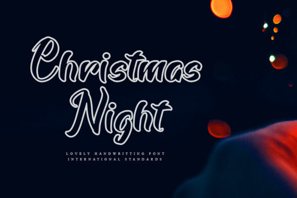 Print on Demand: Christmas Night Script & Handwritten Font By mizanstudio