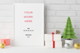 Print on Demand: Mockup Photo Frame with Chritsmas Scene. Graphic Product Mockups By iJStudio