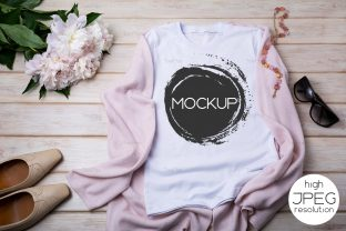 Print on Demand: Women's T-shirt Mockup with Flat Shoes Graphic Product Mockups By TasiPas