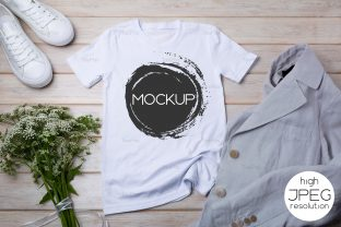 Print on Demand: Women's T-shirt Mockup with Jacket Graphic Product Mockups By TasiPas