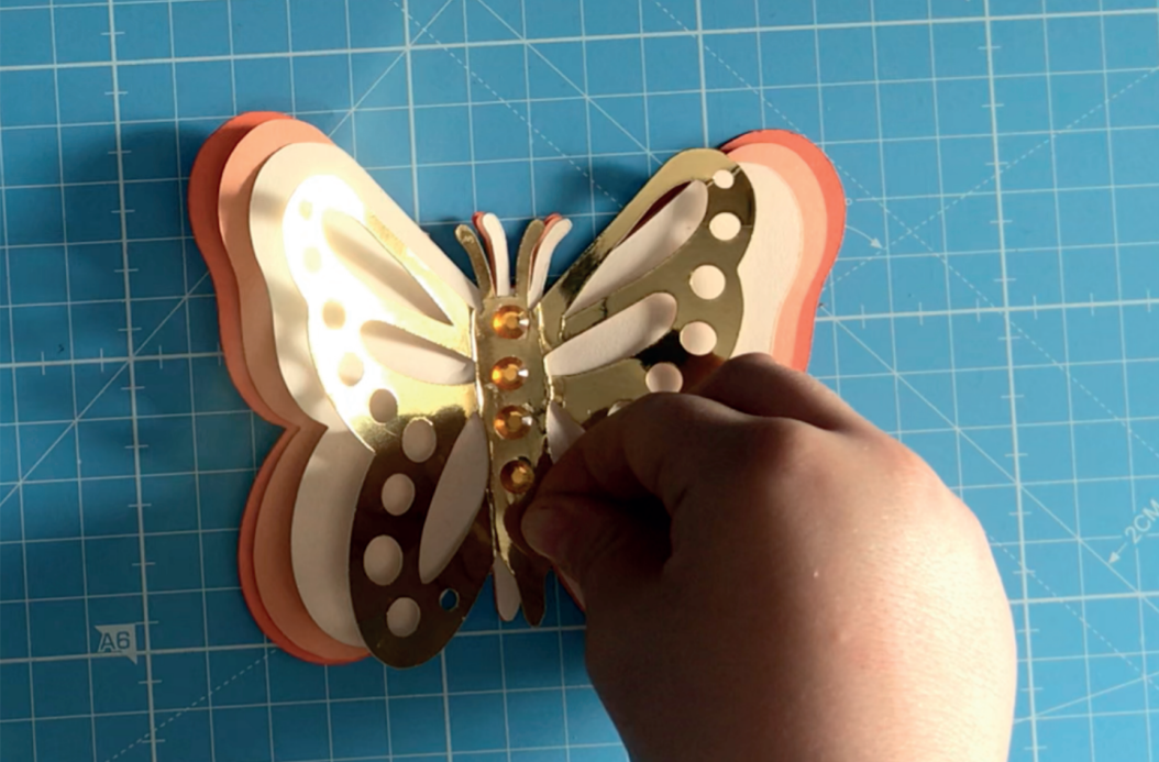 Paper Butterfly with sequins being added