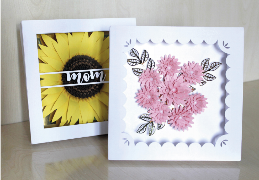 Finished 3D shadow box frames with flowers