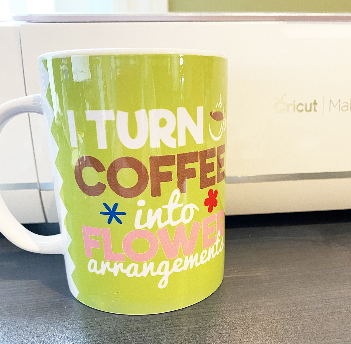 Mug with Cricut Maker in the background