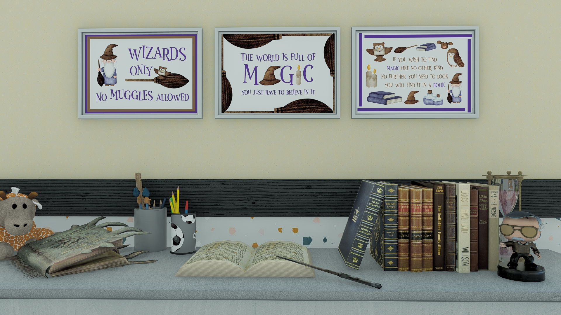 desk with books in front of a wall with three frames